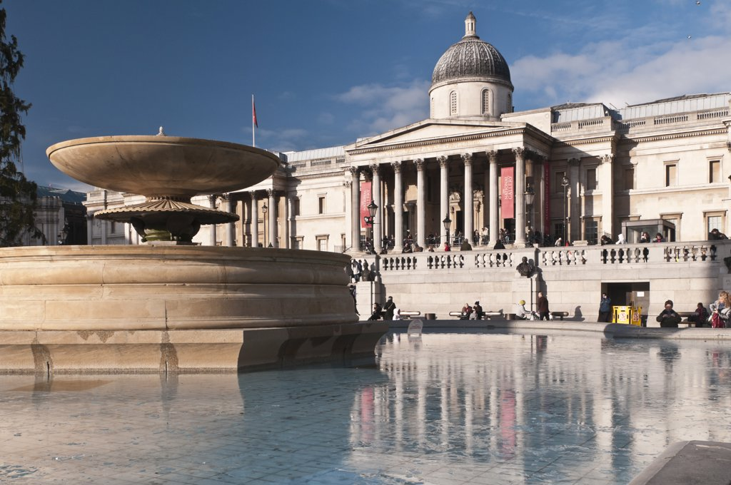 Fountain in front of a museum in winter, National Gallery, Trafalgar Square, City Of Westminster, London, England : Stock Photo