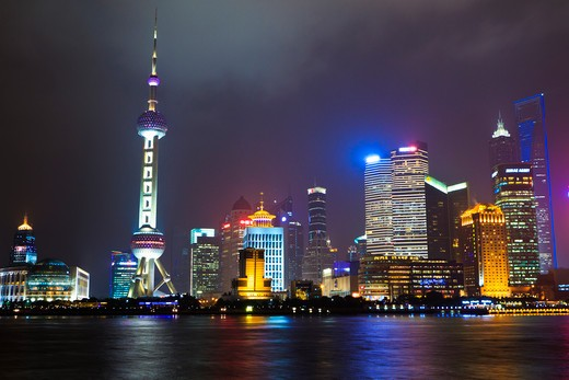 Stock Photo: 4219-186 China, Shanghai, Cityscape of Pudong illuminated at night with Oriental Pearl Tower, Jinmao (Jin Mao) Tower and Shanghai World Financial Tower