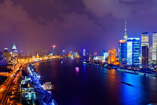 Stock Photo: 4219-194 China, Shanghai, Cityscape of Shanghai with Bund, Huangpu River and Pudong illuminated at night with Oriental Pearl Tower