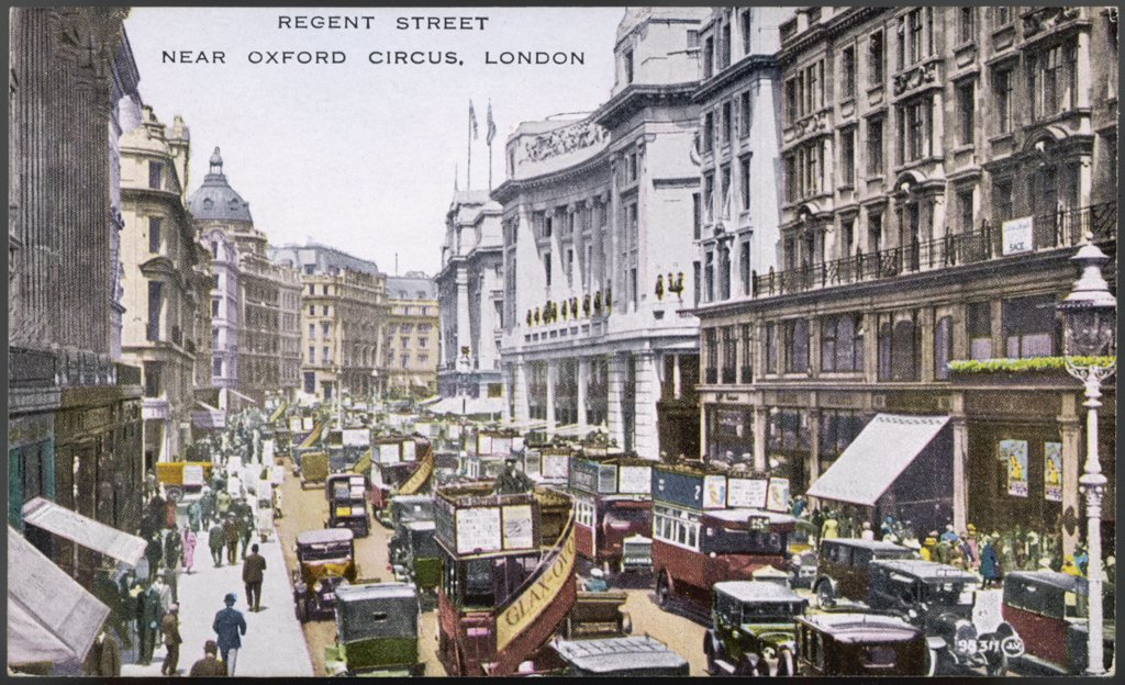 Looking north up Regent Streettowards Oxford Circus, withbuses, cars and cabsDate: circa 1920 : Stock Photo