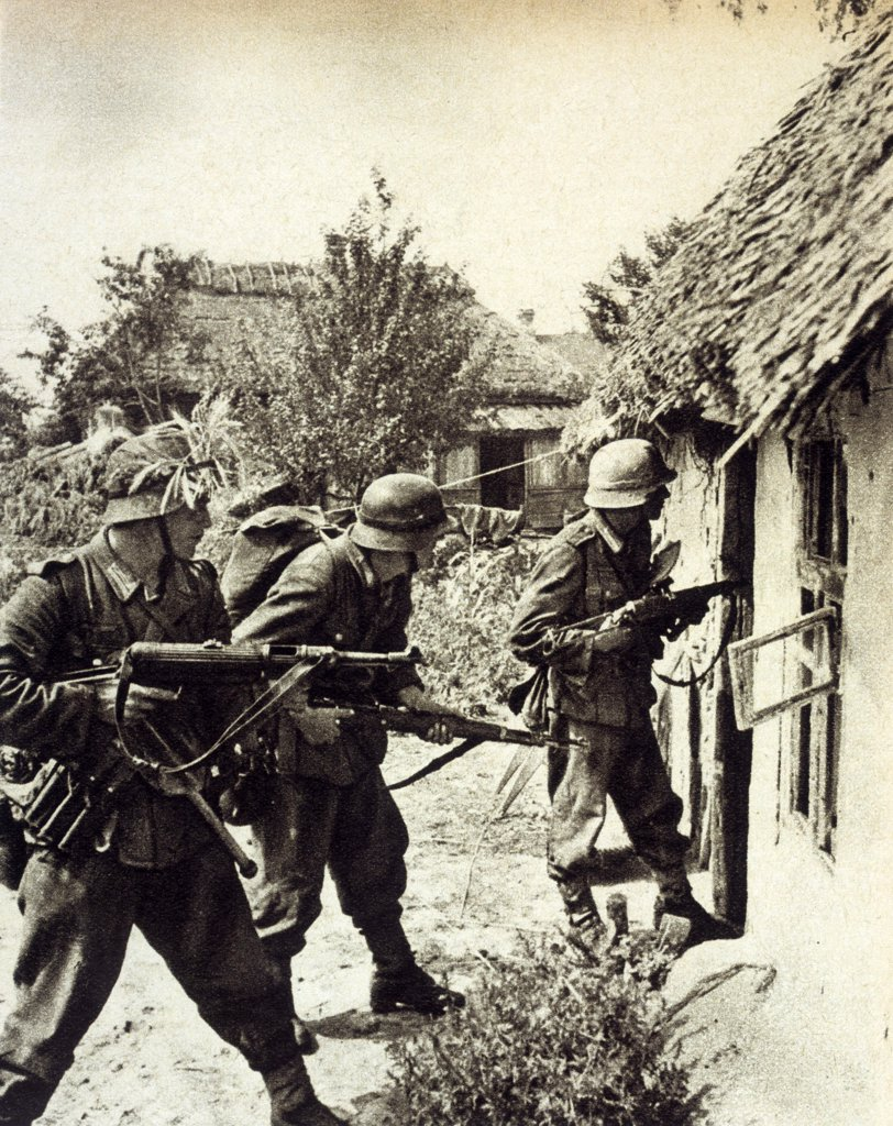 Three German soldiers search a  Russian peasant home : it's  easy while summer lasts, but  soon it will be winter and not  so agreeable      Date: September 1941 : Stock Photo