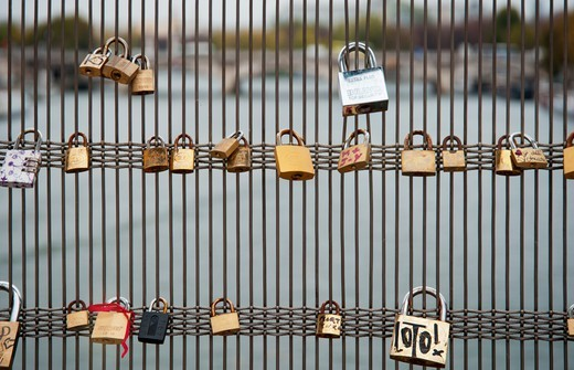 Love locks on a bridge over the Seine River, Paris, France : Stock Photo