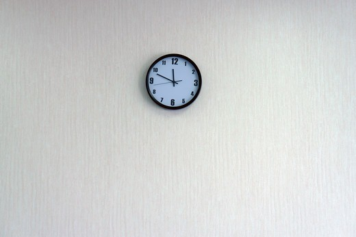 A round clock on a wall : Stock Photo
