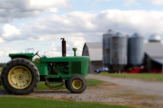 A Parked Tractor at a farm : Stock Photo