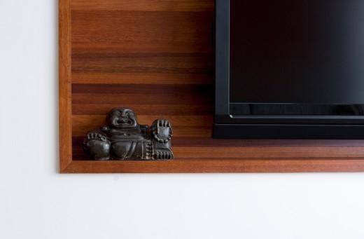 Buddhist Sculpture on Shelf : Stock Photo