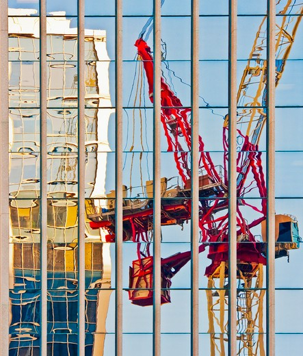 Distorted Reflection of a Tower Crane : Stock Photo