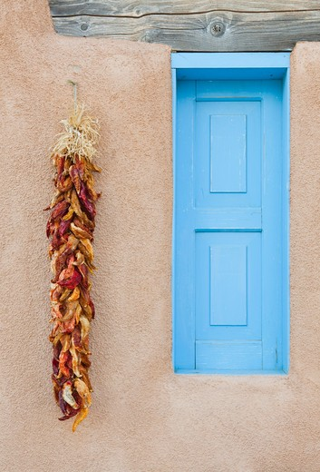 Blue Window with Chili Peppers : Stock Photo