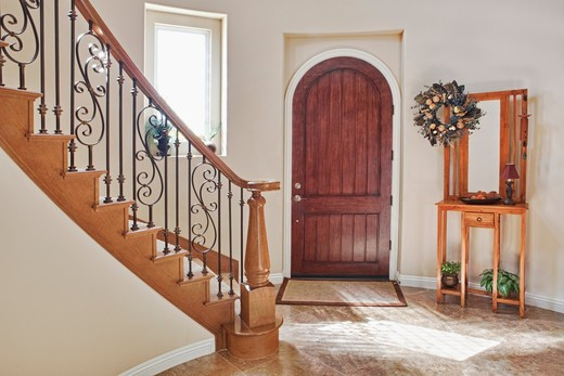 Front door and entryway of home : Stock Photo