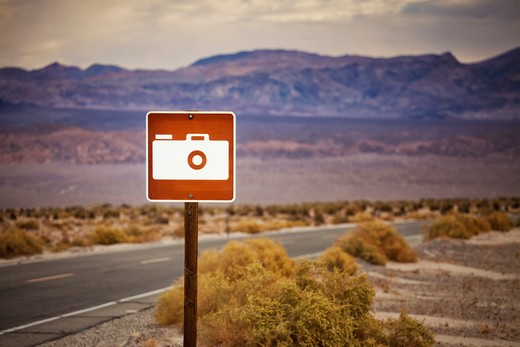 Sign in Death Valley showing camera and indicating picture spot : Stock Photo