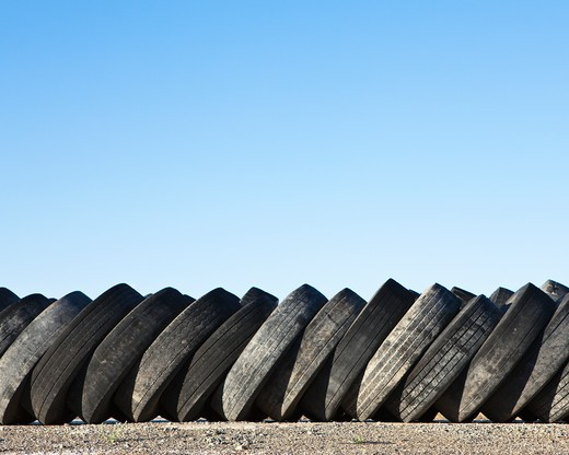 Stack of discarded rubber tires : Stock Photo