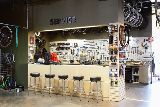 A bicycle shop and repair workshop. : Stock Photo