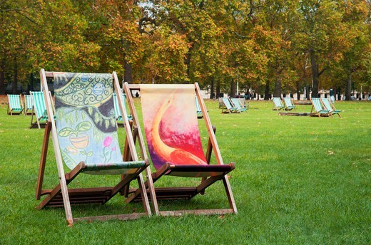 Lawn chairs in a park in London, UK : Stock Photo