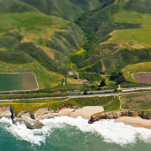 Aerial View of a Coastal Road and Valley : Stock Photo