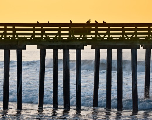Pier by the Ocean at Sunrise : Stock Photo