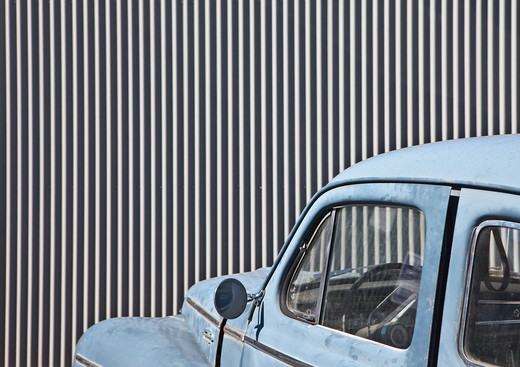Vintage Car in Front of a Metal Wall : Stock Photo