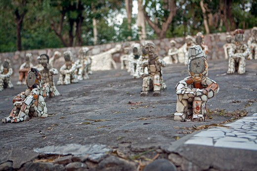 Small Figurines in Rock Garden : Stock Photo