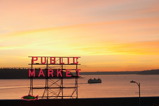 The Public Market sign at the Pike Place Market in the evening light with a ferry boat on Elliott Bay : Stock Photo