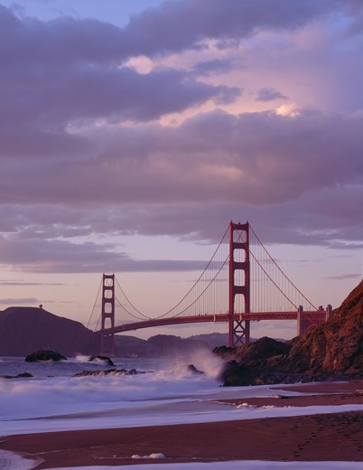 Evening light on the Golden Gate Bridge and Baker Beach, San Francisco, California. : Stock Photo