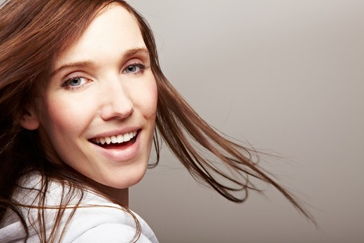 Stock Photo: 4232R-1621 Happy smiling woman with long brown hair dancing
