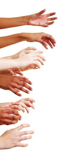 Many empty hands reaching to the side : Stock Photo