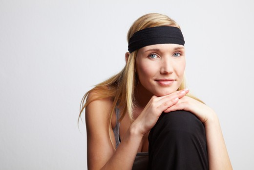 Stock Photo: 4232R-1969 Young releaxed woman with black headband smiling