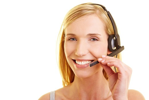 Happy young woman with headset on her head : Stock Photo