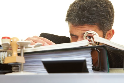 Businessman looking through files : Stock Photo