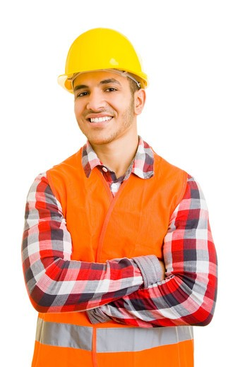 Smiling moroccan construction worker with his arms crossed : Stock Photo
