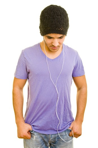 Stock Photo: 4232R-2755 Teenager with in-ear headphones listening to music