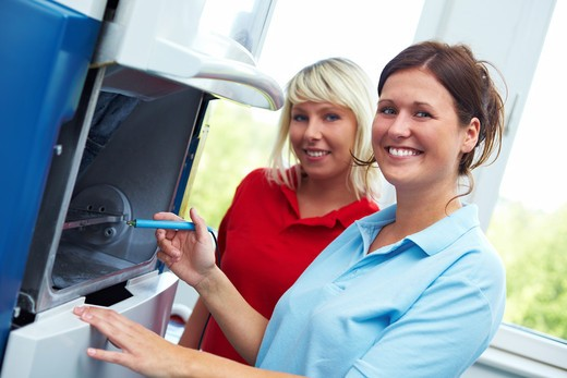 Stock Photo: 4232R-3130 Two Dental technicians with a CAD/CAM sytem
