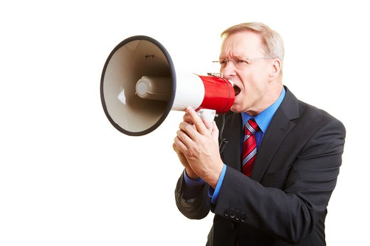 Stock Photo: 4232R-828 Senior businessman screaming loudly in a big megaphone