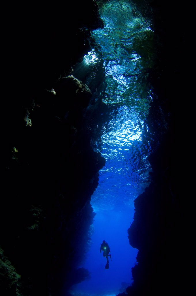 A diver explores the amazing underwater cavern known as Lerus Cut, Russell Islands, Solomons. : Stock Photo
