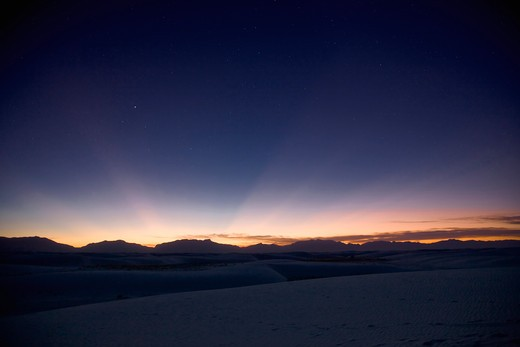 Stock Photo: 4239R-1354 Sunset landscape depicting crepuscular rays at White Sands National Monument, New Mexico