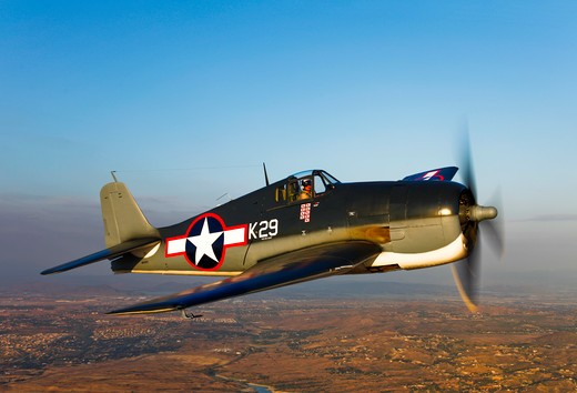 Stock Photo: 4239R-1384 A Grumman F6F Hellcat fighter plane in flight over Chino, California