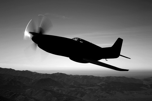Stock Photo: 4239R-1400 A Grumman F6F Hellcat fighter plane in flight over Chino, California