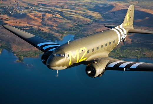 A Douglas C-53 Skytrooper variant of the DC-3/C-47 family of aircraft, unique in its cargo door and interior cargo/parachute configuration : Stock Photo