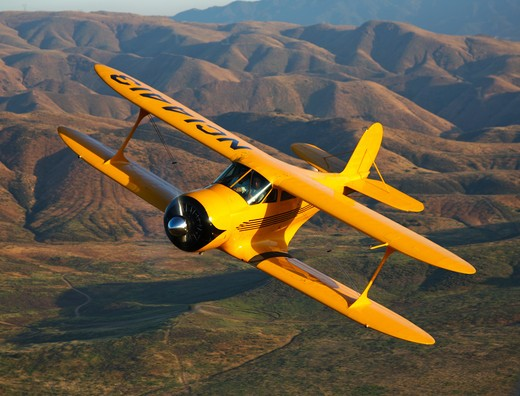 Stock Photo: 4239R-1413 A Beechcraft D-17 Staggerwing in flight near Chino, California