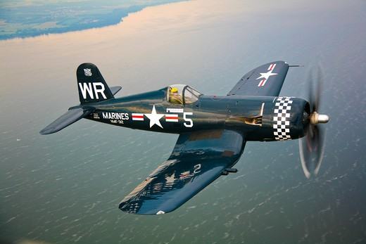 A Vought F4U-5 Corsair in flight near Oshkosh, Wisconsin : Stock Photo
