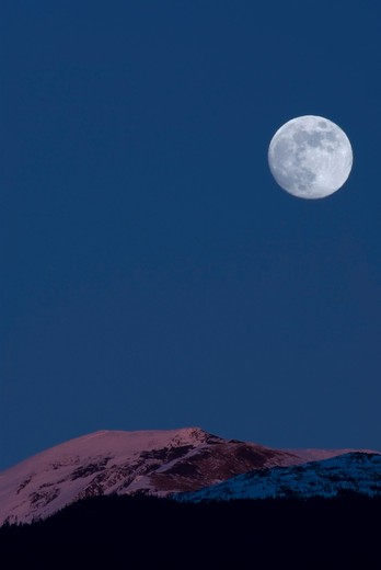Stock Photo: 4239R-1453 January 31, 2007 - Full Moon at Alpenglow, New Aiyansh, British Columbia, Canada