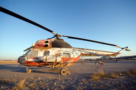 Stock Photo: 4239R-1491 Baqubah, Iraq - An Iraqi Mi-2 helicopter sits on the flight deck abandoned at Camp Warhorse