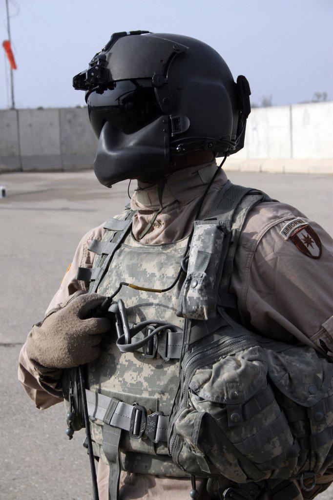 Stock Photo: 4239R-1550 Baqubah, Iraq - A Medivac Loadmaster waits as the pilots run through their pre-flight checks