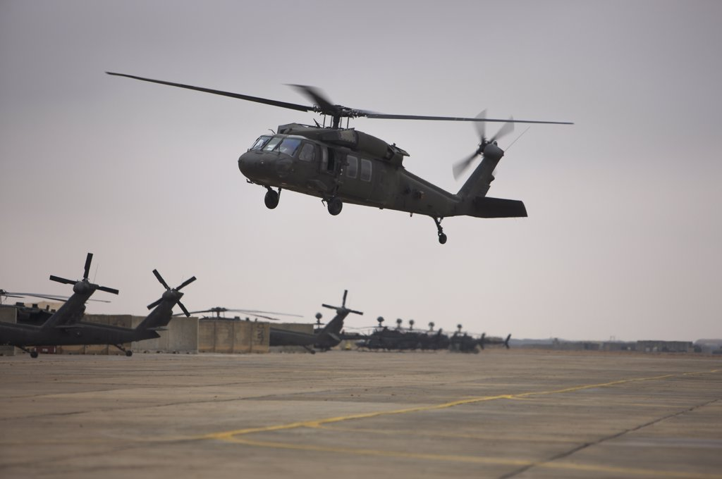 A UH-60 Black Hawk taking off for a mission over northern Iraq : Stock Photo