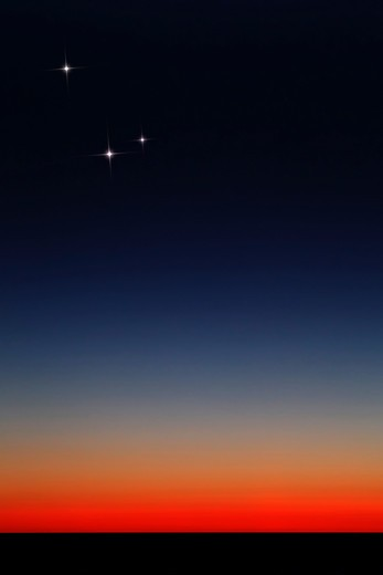 Stock Photo: 4239R-1972 Venus, Mercury and Mars above the glowing horizon at dawn.