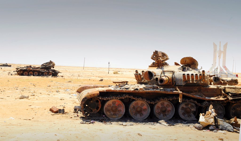 Stock Photo: 4239R-2423 A T-80 tank destroyed by NATO forces in the desert north of Ajdabiya, Libya.  A war betwean Gaddafi army and Libya's Transitional National Council army with air support from NATO started on March 17, 2011.