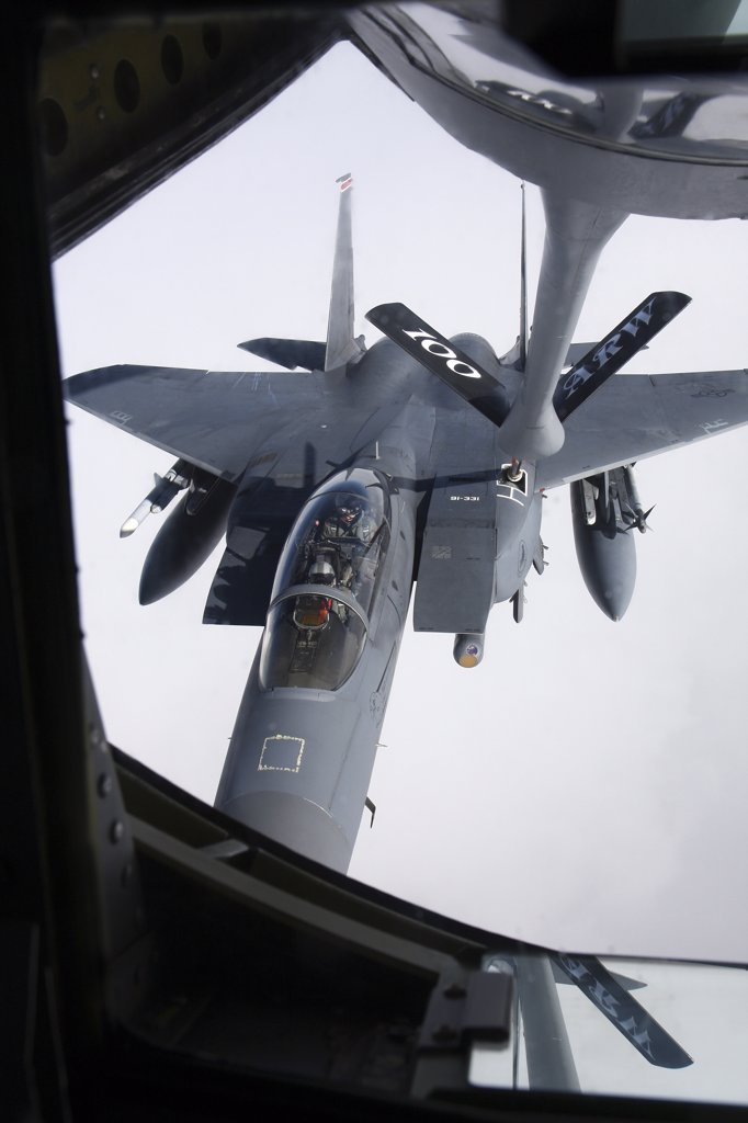 Stock Photo: 4239R-2884 Air refueling a McDonnell Douglas F-15E Strike Eagle of the U.S. Air Force.