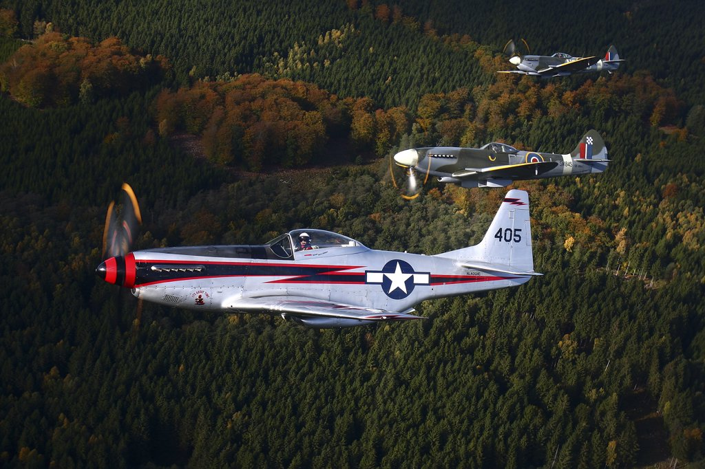 Stock Photo: 4239R-2928 Angelholm, Sweden - North American P-51 Cavalier Mustang with Supermarine Spitfire Mk. XVIII and Mk. XVI fighter warbirds.