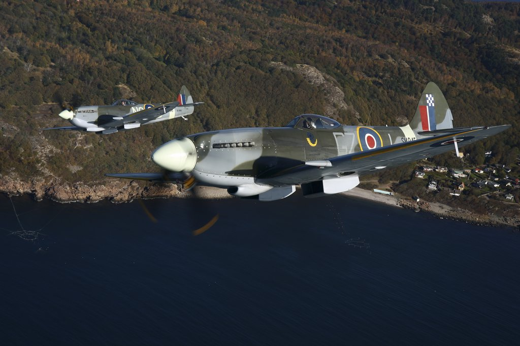 Stock Photo: 4239R-2932 Angelholm, Sweden - Supermarine Spitfire Mk. XVIII and Mk. XVI fighter warbirds.