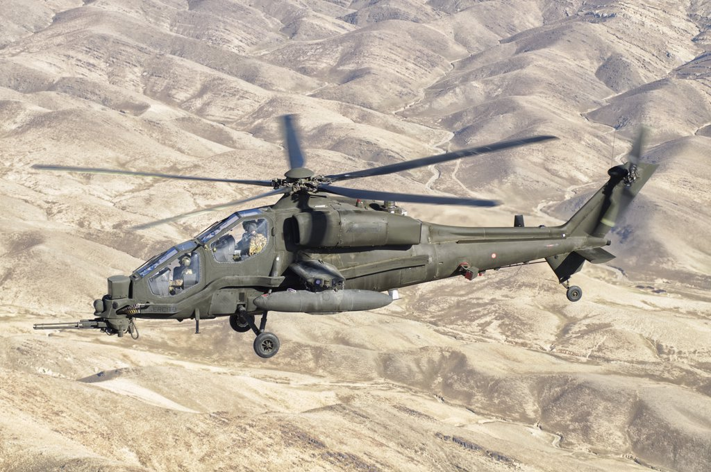 Stock Photo: 4239R-3015 An Italian Army AW129 Mangusta over Afghanistan. The helicopter is assigned to task force Fenice at Forward Operating Base Herat in the Regional Command West.