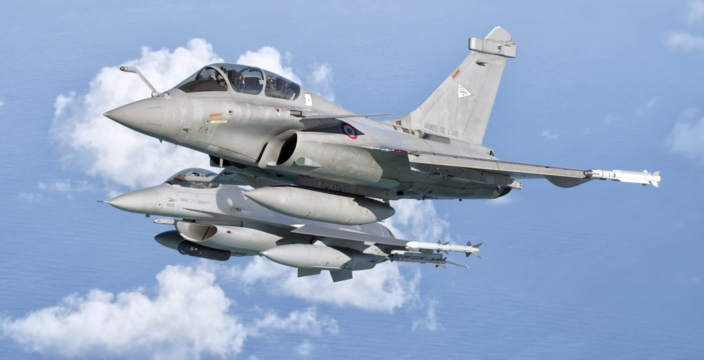 Stock Photo: 4239R-3021 A Dassault Rafale of the French Air Force flys alongside a U.S. Air Force F-16C Fighting Falcon over Brazil during Cruzeiro Do Sul (CRUZEX). CRUZEX V is a multinational exercise encompassing real means from the Air Forces of Argentina, Brazil, Chile, France, Uruguay, United States, Venezuela and simulated means from Land and Maritime Components that takes place October 28th to November 19th, 2010, on the Northeast coast of Brazil.