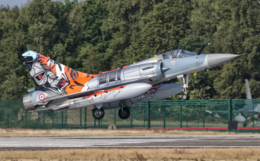 A French Air Force Mirage 2000 lands on the runway at Kleine Brogel Air Base, Belgium, during Tiger Meet 2009. : Stock Photo